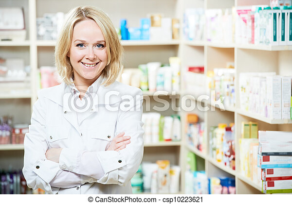 Pharmacy chemist woman in drugstore - csp10223621