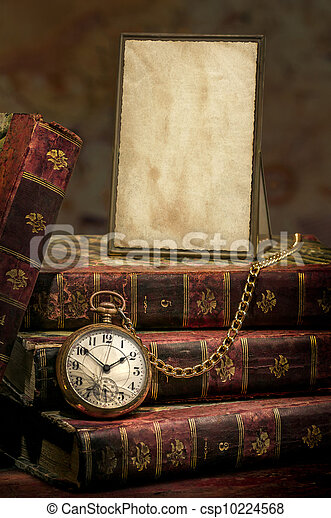 Frame with old photo paper texture, pocket watch and books in Low-key - csp10224568
