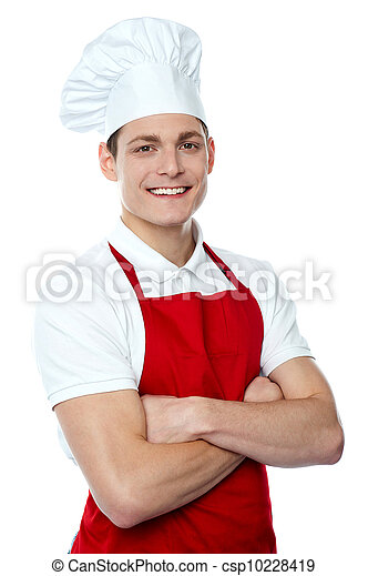 Smiling young chef posing with crossed arms - csp10228419