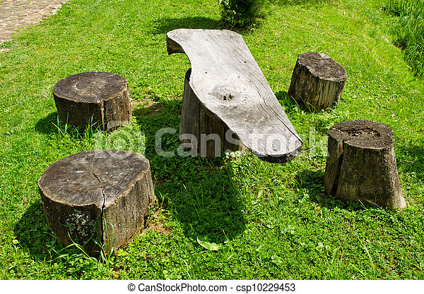 Table and chairs of wood trunk stumps. Rest place - csp10229453