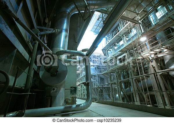Equipment, cables and piping as found inside of  industrial power plant - csp10235239