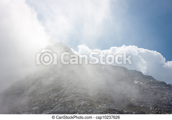Alpine scenery: mountain peak in the clouds - csp10237626
