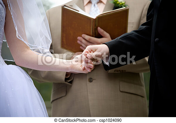 holding hands during a wedding ceremony - csp1024090