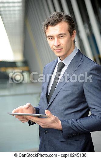 Business man on his ipad. - csp10245138