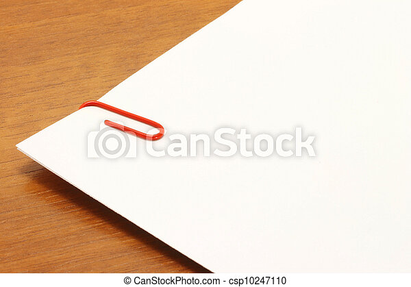 Piece of paper with a red clip on t