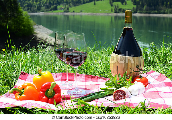 Wine and vegetables served at a picnic on Alpine meadow. Switzerland - csp10253926