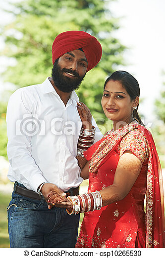 Happy indian young adult married couple - csp10265530