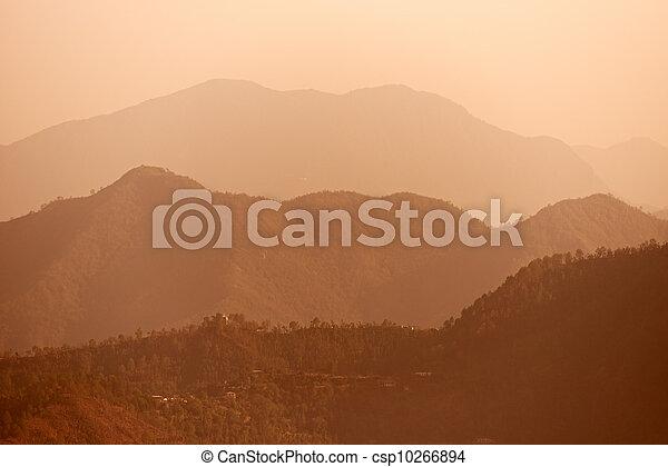 Early morning foggy indian Himalayas mountains - csp10266894
