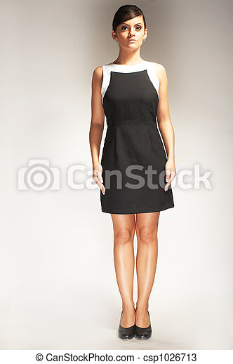 Fashion model Posed on light background in black dress - csp1026713