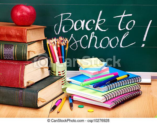 Books and blackboard. School supplies.
