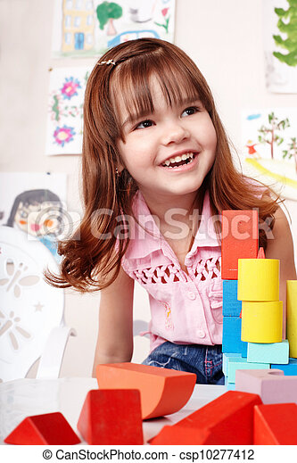 Child with  block and construction set in play room. - csp10277412