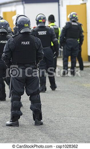 Uk Police Officers in Riot Gear - csp1028362