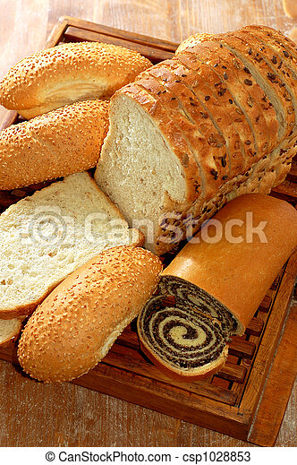 assortment of baked bread and other bakery products - csp1028853