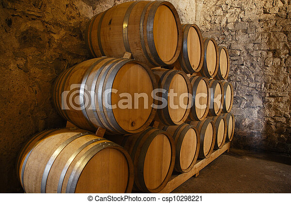 Wine barrels in a old wine cellar - csp10298221