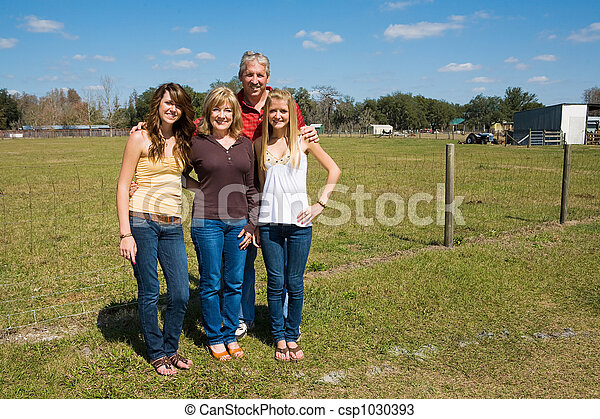 Beautiful Family on Farm - csp1030393