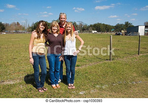 Beautiful Family on Farm - csp1030393