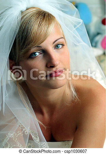 Smiling bride in white wedding dress - csp1030607