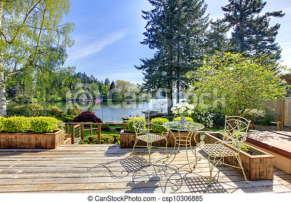 Large deck with chairs and water lake view.. - csp10306885