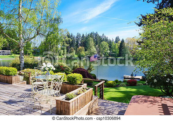 Beautiful deck near lake with spring landscape. - csp10306894