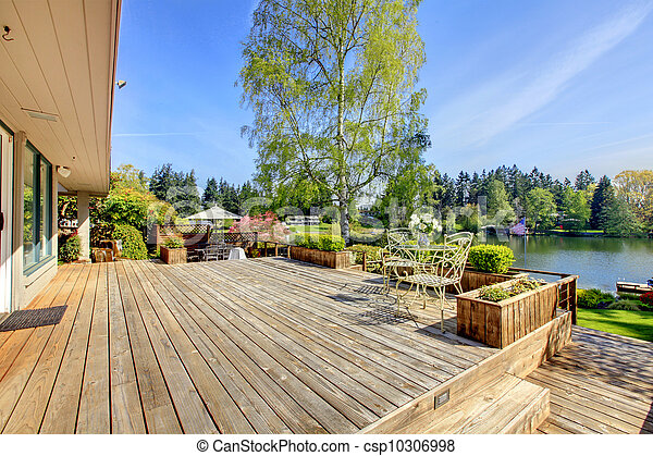 Large wood deck with lake and spring landscape. - csp10306998