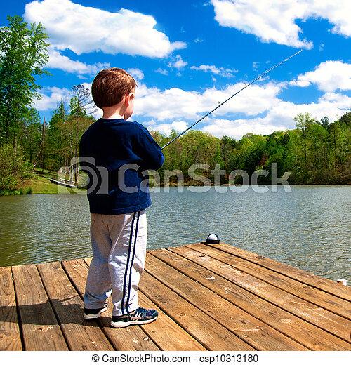 Boy fishing from dock on lake - csp10313180
