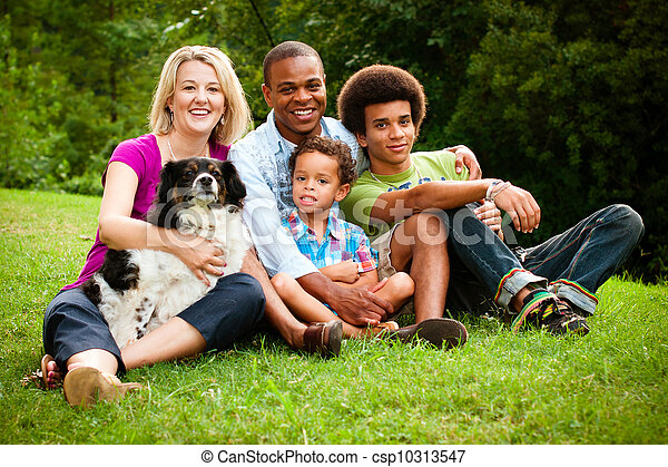 Portrait of mixed race family at park - csp10313547