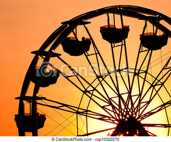 Silhouette of ferris wheel at sunset at county fair. - csp10322270