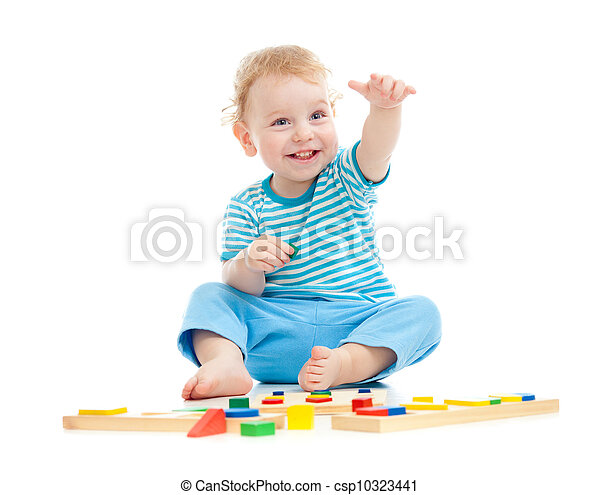 Happy cheerful kid playing educational toys isolated on white - csp10323441