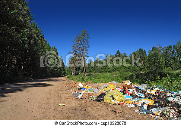 garbage pit on rural road near wood - csp10328878