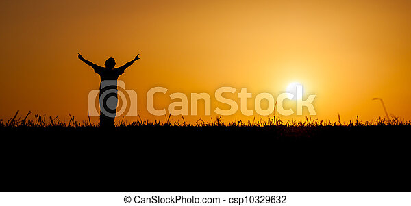 Person celebrating life at sunset - csp10329632