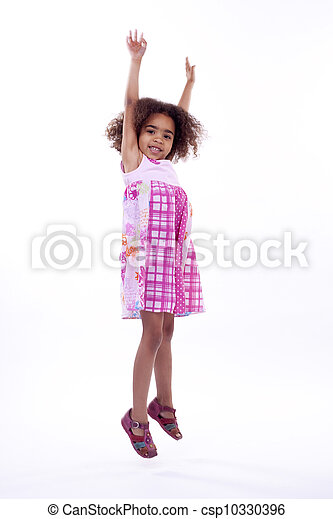 Little South African girl jumping on white background.