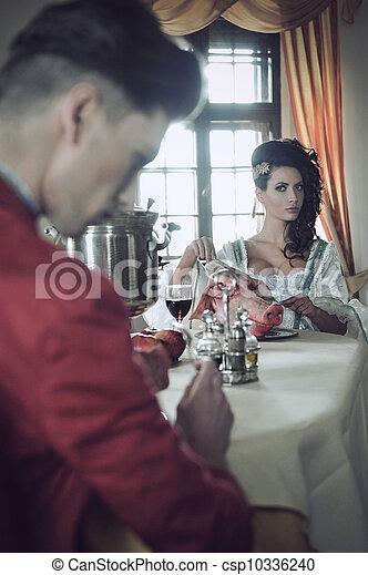 Young couple having strange breakfast - csp10336240