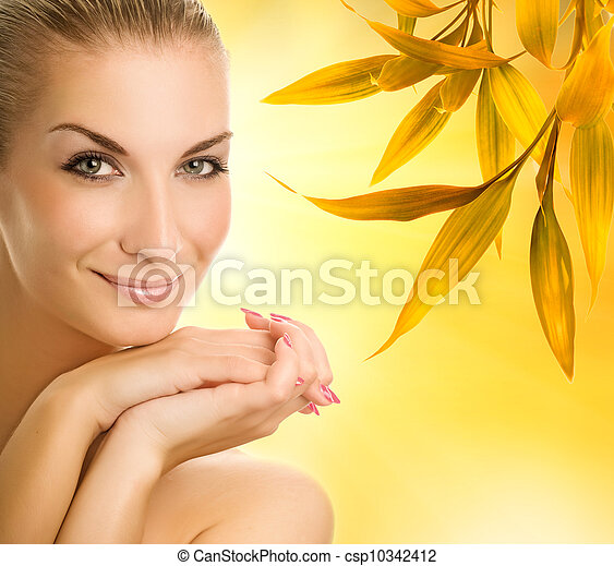 Beautiful young woman over abstract autumn background - csp10342412