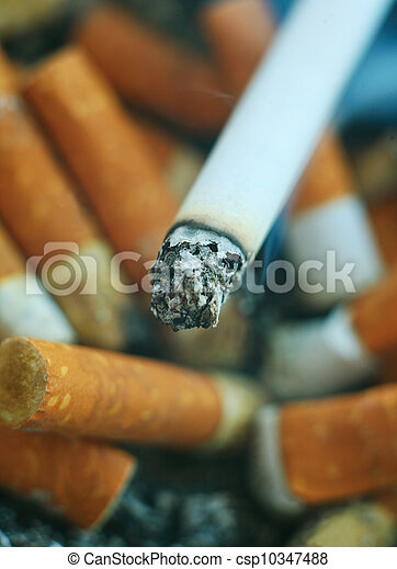 Smoking cigarette and stubs - csp10347488