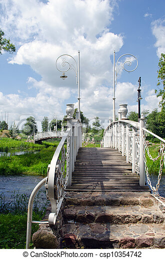 White decorative bridges through park stream sky - csp10354742