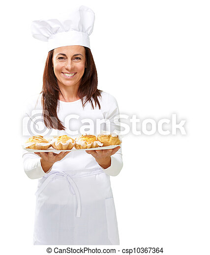 Woman chef holding baked food - csp10367364