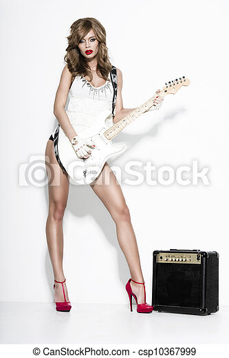 sexy fashion girl  with a guitar - csp10367999