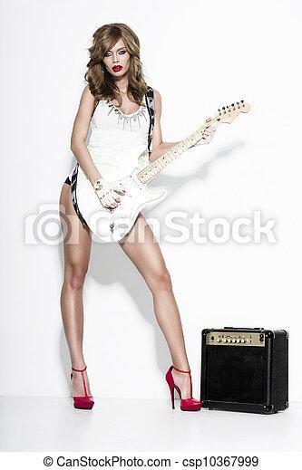 sexy fashion girl  with a guitar - csp10367999