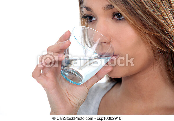 Woman drinking a glass of water - csp10382918
