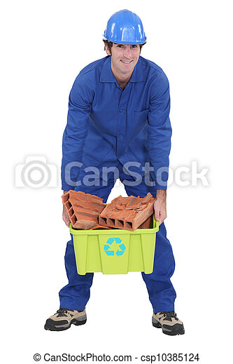 craftsman carrying a box with bricks - csp10385124