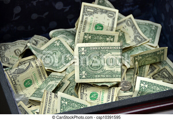 Stock Photographs of tip money in box - Dollar bills and coins in ...