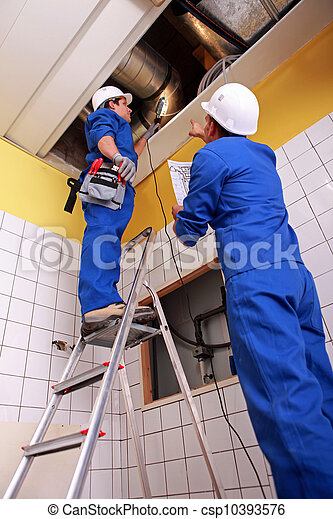 Man and woman repairing ventilation system - csp10393576