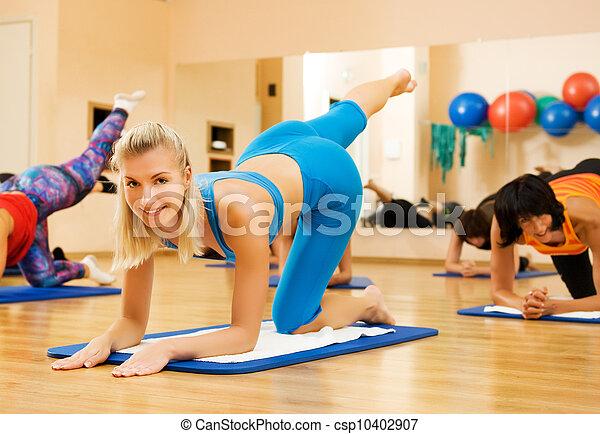 Beautiful women exercising in fitness club - csp10402907