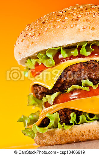Tasty and appetizing hamburger on a yellow - csp10406619