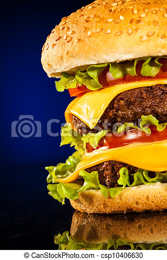 Tasty and appetizing hamburger on a dark blue - csp10406630
