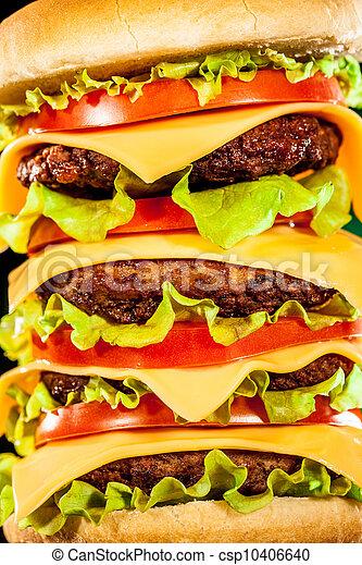 Tasty and appetizing hamburger on a dark - csp10406640
