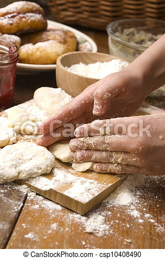 Detail of hands kneading dough - csp10408490