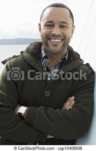 Young Black Man on Boat Deck - csp10408938