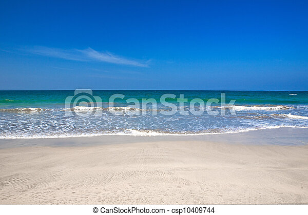 Beautiful beach with crystal clear blue waters the sea against blue sky . - csp10409744