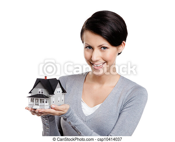 Holding small toy house - csp10414037